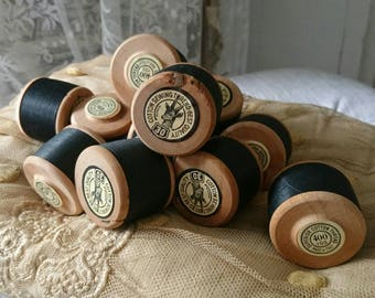 Vintage wooden bobbin. Silky black thread. 400 yards. Milinary stock.