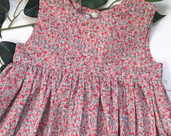 Liberty London Floral Cotton Lawn Girls Dress. Red and neutral colours. Smock dress 0-10 years.