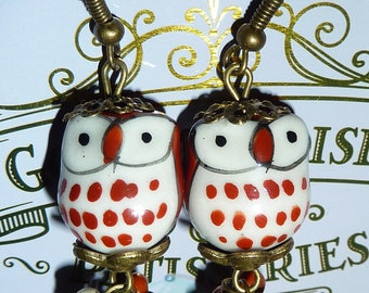 Metal bronze earrings with a brown owl made with ceramic and beads
