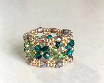 Emerald and Peridot woven glass bead ring size 6.5