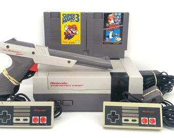 Nintendo NES Console Bundle Tested Works Cleaned