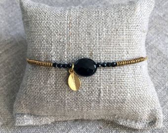 Small still - Onyx and gold plated bracelet