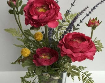 Ranunculus and Lavender one sided arrangement in a rectangle clear glass vase.