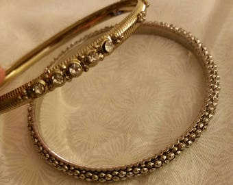 2 Bangles one silver tone and one gold tone