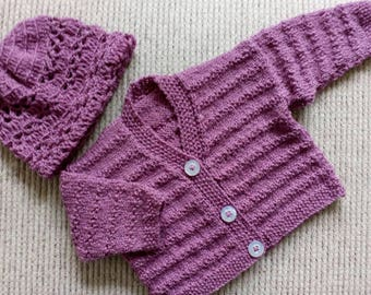Gorgeous cardigan and hat in berry colour wool fits nine to twelve months.