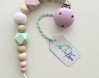 Pacifier in pastel shades with crochet beads