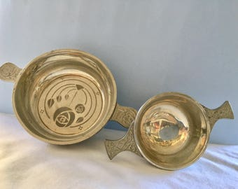 Two Celtic styled pewter porringers or quaiches