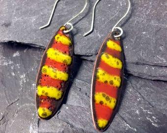 Kiln fired vitreous enamel earrings / oval dangle earrings / sterling silver hooks / hand crafted / copper earrings / orange / yellow /