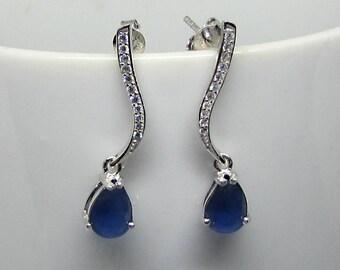 Silver CZ Teardrop Earrings. Dangling earrings. These stud earrings. Blue earrings