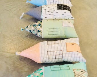 fun pillow in the shape of little houses