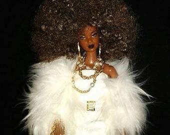 Coach AA barbie doll wearing a white coach dress with white fur