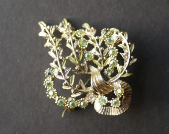 Pretty floral painted brooch with green enamel and aurora rhinestones, heather flowers