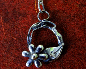Handmade silver pendant with flower and leaf