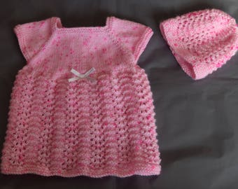 A speckled pink hat and dress for baby