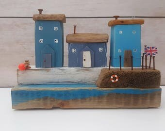 Driftwood gift of a harbour village made by amongst the pebbles