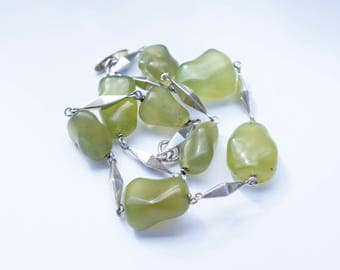 Silver necklace with peridot stones