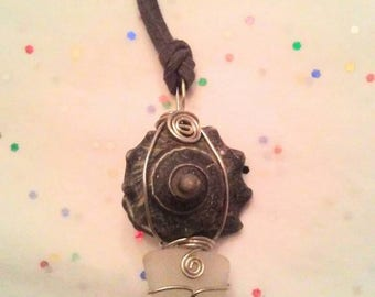 Snail shell + clear sea glass wire wrap necklace