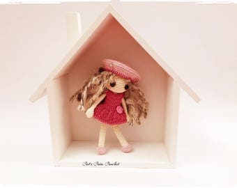 Small decorative doll in her house to hang