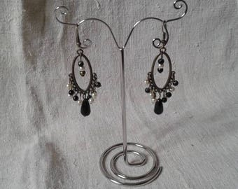 black and white beads and bronze earrings