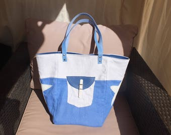 Blue linen tote bag and bright white linen.