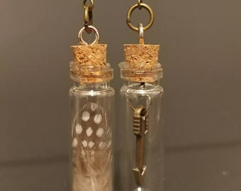 Glass Bottle Earrings with a bronze arrow, and feathers Mixmatched