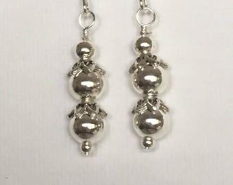 Silver drop earrings. Silver dangle earrings. Silver balls earrings. Silver embellishments on silver ear wires.
