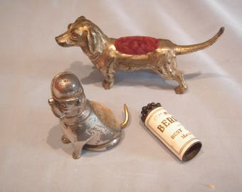 Two Charming Antique Dog Pin Cushions and a packet of vintage Pins