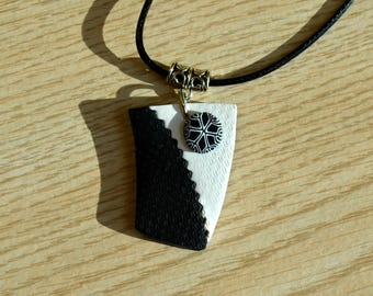 Hand made black and white polyme clay pendant