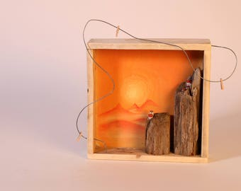 tiny house in driftwood landscape - alpenglow