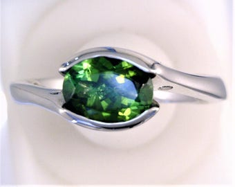Oval Green Tourmaline in 18 carat White Gold
