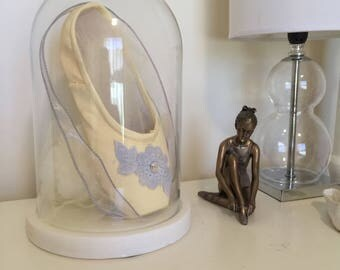 Deocorated pointe shoe in glass cloche