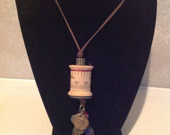 Vintage Thread Spool Necklace with charms, Brown Cord .One of a kind. 26 in cord.