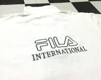 Vintage Fila half zip shirt embroidered spell out big logo Size L Fila international Good condition