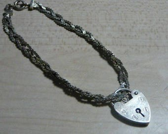1960 English hallmarked sterling silver .925 braided chain 7 inch bracelet and heart charm / locket