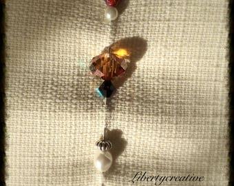 Brooch pin amber and grey Crystal beads.