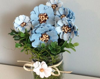Blue Daisies in glass vase