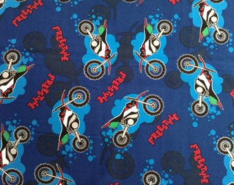 Motorcycle/Freestyle on blue background cotton fabric by the yard