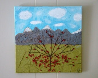 Original 12x12 fallen blooms mixed media canvas. #mixedmediaart #canvasart #treeart #flowerbloomsart #mountainrangeart #cloudsart #gift