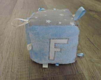 Educational with letter cube, fabric with noise maracasse sensory