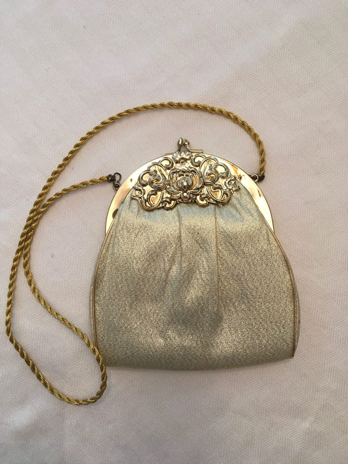 58eb89275098 HL Gold lame evening bag with floral repousse frame