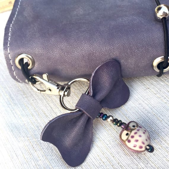 Adorable leather bow planner charm with owl on swivel clasp!  This charm will add character to your planner, traveler's notebook, or journal