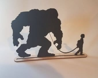 A Boy Walking His Bigfoot