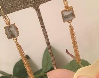 Chain tassel earrings.