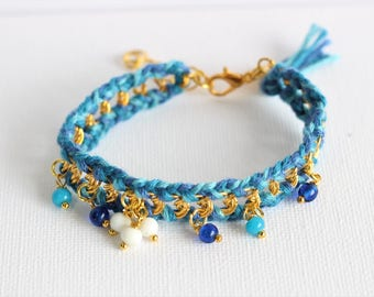 Blue braided bracelet on gold chain