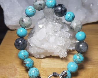 Combined with Tibetan turquoise and Merlinita with closure in silver helm bracelet