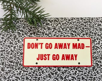 50's General Mills Novelty Cereal Bike Enamel License Plate 'Don't Go Away Mad- Just Go Away'