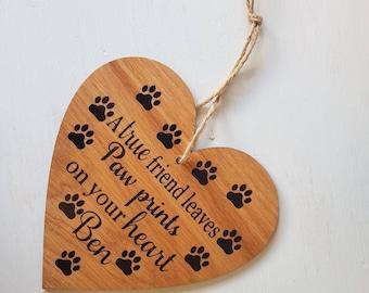 A true friend leaves paw prints on your heart, hanging oak pet memorial plaque. Personalised pet memorial.