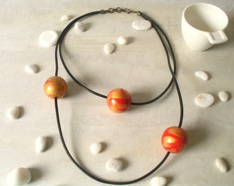 Hand painted wooden large beads necklace, unique black leather cord and red gold wooden beads, wearable art, statement necklace, fashion.