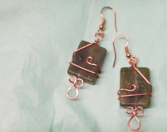 Green stone wrapped in copper