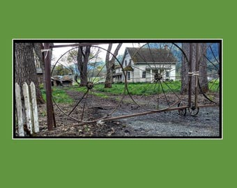 Rouge River House, with wagon wheel Gate.